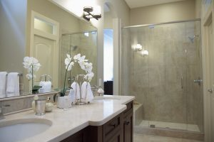 bathroom remodeling Main Line white themed bathroom with walk in shower and dark cabinets